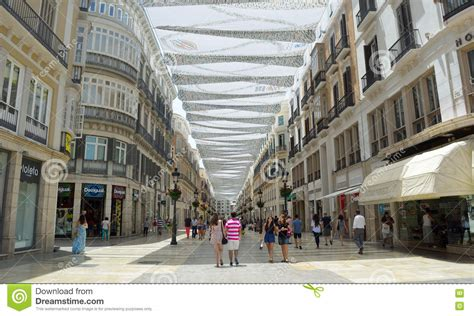 Shoppers Under Canopy Covered Pedestrian Shopping Street