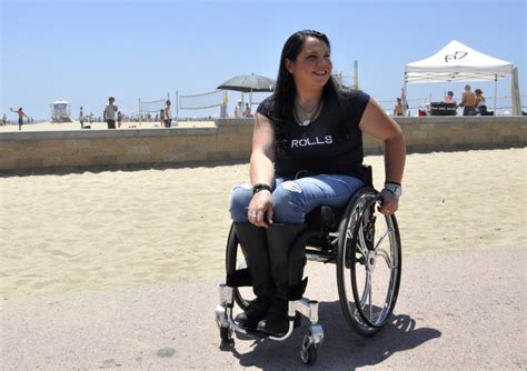 Disabled surfer goes from wheelchair to waves following