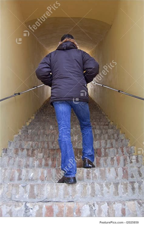 Picture Of Young Man Walking Upstairs